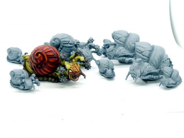 Giant snails and flail snail resin minis from Mystic Pigeon Gaming